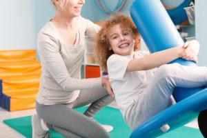 Mother & Daughter Using Pediatric Equipment
