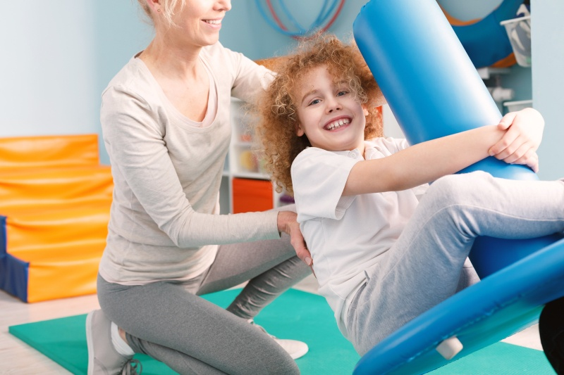Mother & Daughter Using Pediatric Equipment